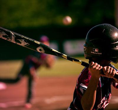 Baseball player aiming for the ball